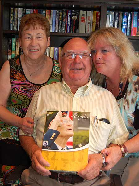 Volunteers Geraldine and Bernie Lynn with Nancy Peck congratulating Bernie on his story as it appeared in the 2013 edition of Angels In Grey