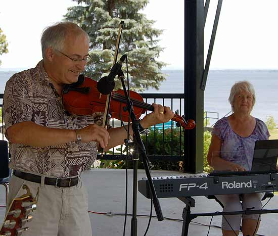 Richard Quirt plays a violin while his wife Rita plays an electric piano