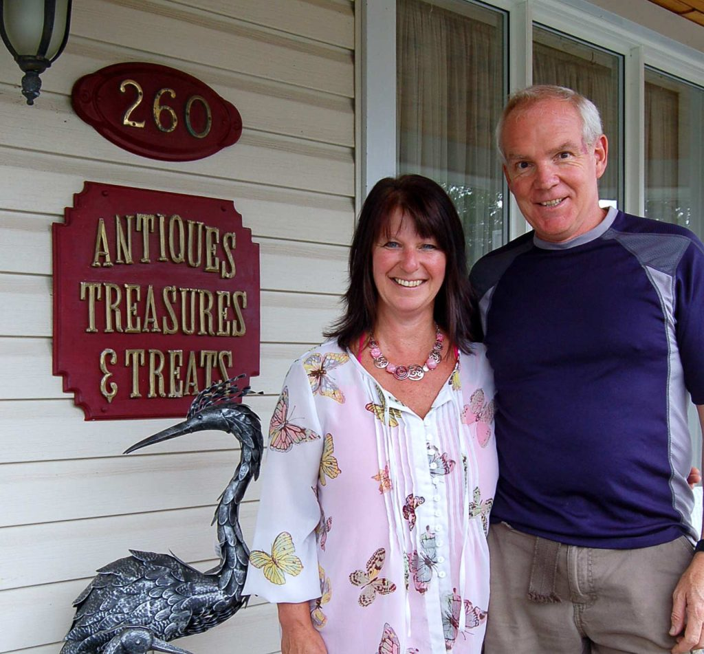 Judy and Mike Wilson in front of their store